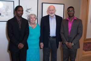 Scholarship recipients Quinn Mason (left) and Kenoly Kadia (right) flank donors Norma and Don Stone.