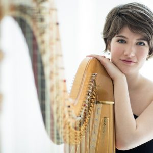 Emily Levin poses with her harp