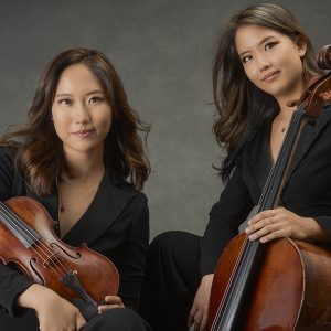 Julia Choi with her violin; Jennifer Choi with her cello